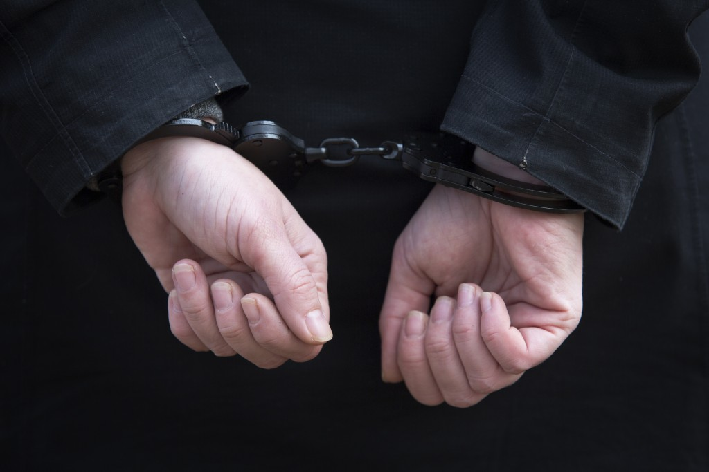 person'e hands handcuffed