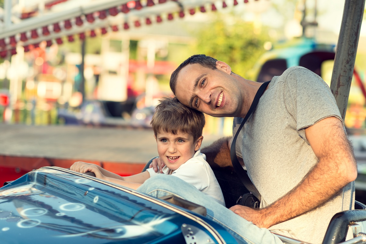 dad in a bumper car with his child